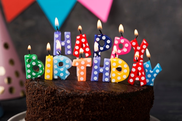Assortment with birthday candles and cake Free Photo