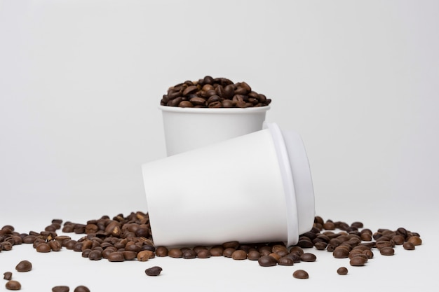 Assortment with coffee cups and beans Free Photo
