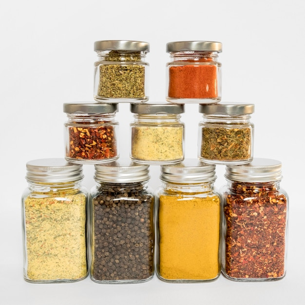 Assortment with different spices in jars Free Photo