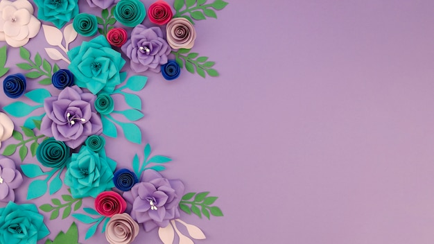 Assortment with floral frame and purple background Free Photo