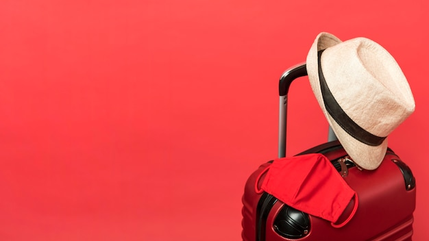 Assortment with luggage and red background Free Photo
