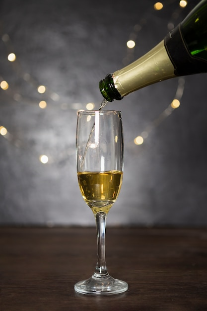 Assortment with pouring champagne and glass Free Photo