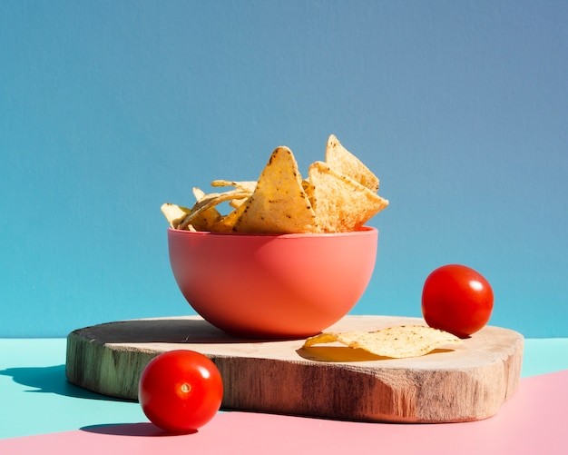 Assortment with tortilla chips and cherry tomatoes Free Photo