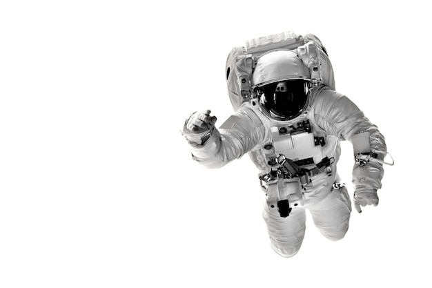 Astronaut flies over the earth in space. Premium Photo