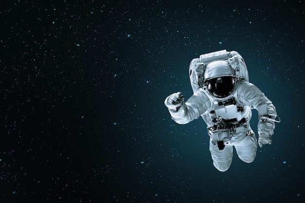 Astronaut floating in space Premium Photo