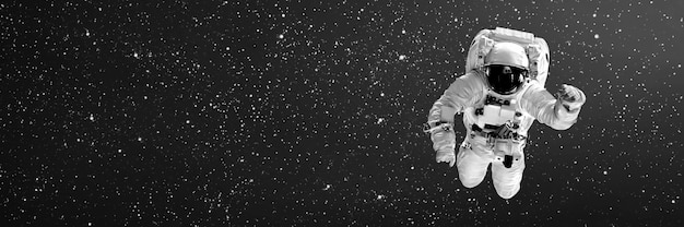 Astronaut flying in space with copy space Premium Photo