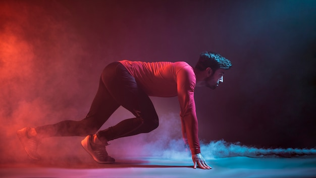 Athlete on crouch start in studio Premium Photo