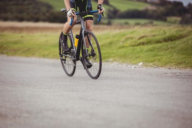 Athlete riding his bicycle Free Photo