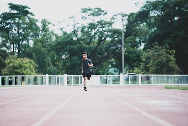 Athlete standing on an all-weather running track Free Photo