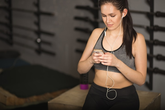 Athlete Using Mobile Phone App Fitness Tracker For Tracking Weight Loss Progress Premium Photo