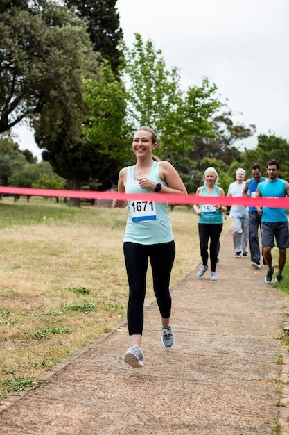 Athletes running race in park Premium Photo