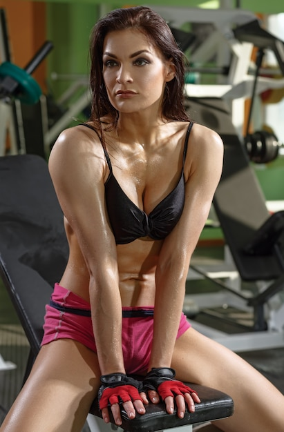 Athletic girl resting after workout Premium Photo