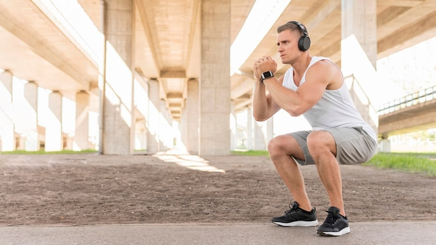Athletic man training outside with copy space Premium Photo