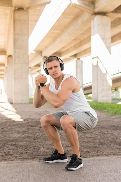 Athletic man training outside Free Photo