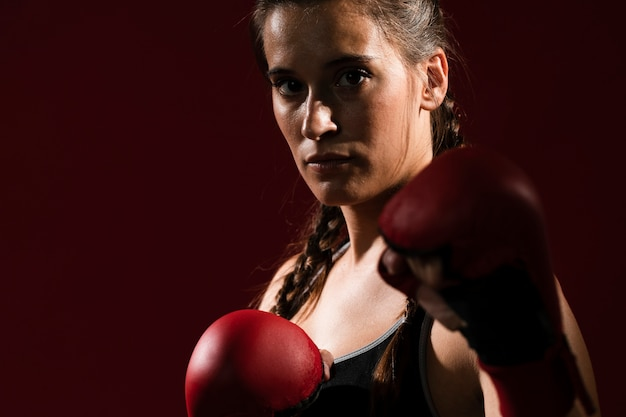 Athletic woman in fitness clothes and box gloves Free Photo