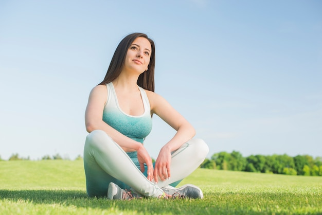 Athletic woman practicing yoga outdoor Free Photo