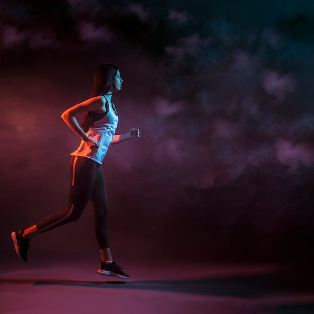 Athletic woman running in studio Free Photo