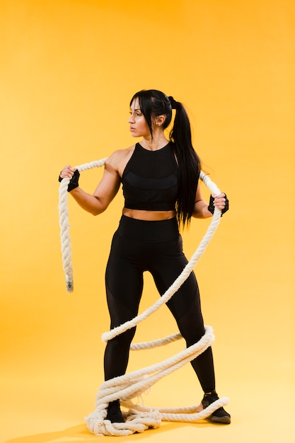 Athletic woman with rope Free Photo
