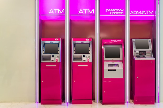 Atm (automatic teller machine) adm(automatic cash deposit machine) and passbook update Premium Photo