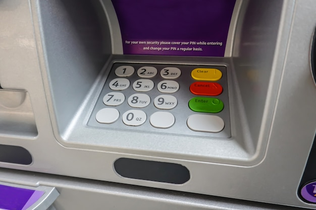 Atm machine closeup at button number code to withdraw transfer money finance Premium Photo