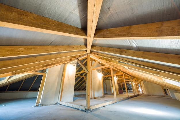 Attic of building with wooden beams of roof structure. Premium Photo