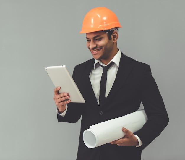 Attractive afro american businessman in protective helmet. Premium Photo