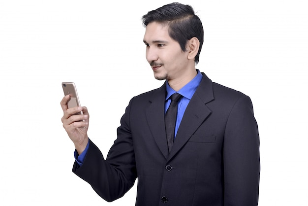 Attractive asian businessman using cell phone Premium Photo