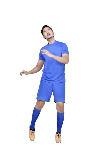 Attractive asian male soccer player heading the ball Premium Photo