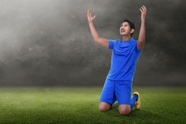 Attractive asian soccer player celebrate his victory Premium Photo