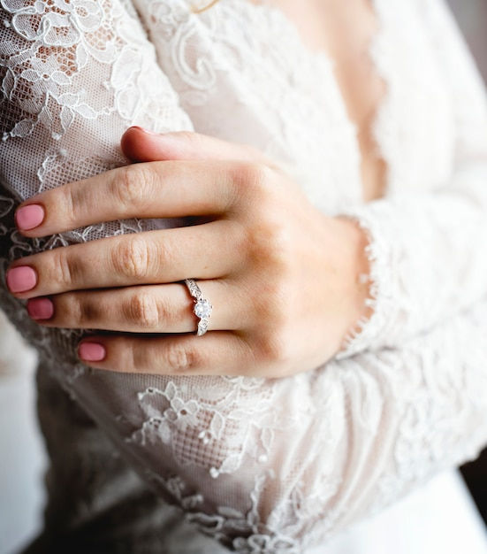 Attractive beautiful bride showing engagement wedding ring on hand Free Photo