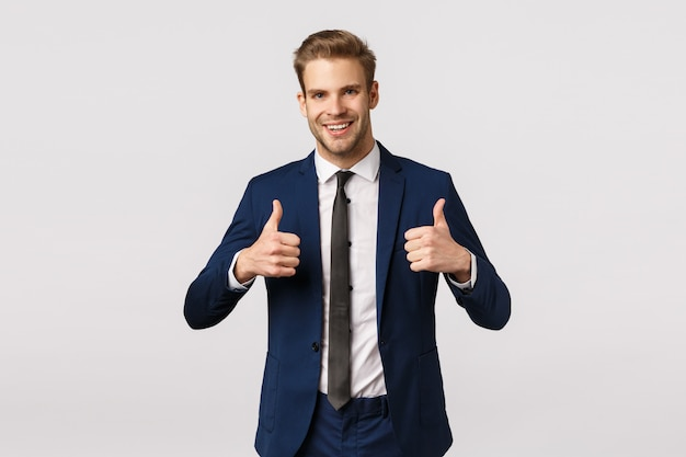 Attractive blond bearded businessman showing thumbs up Premium Photo