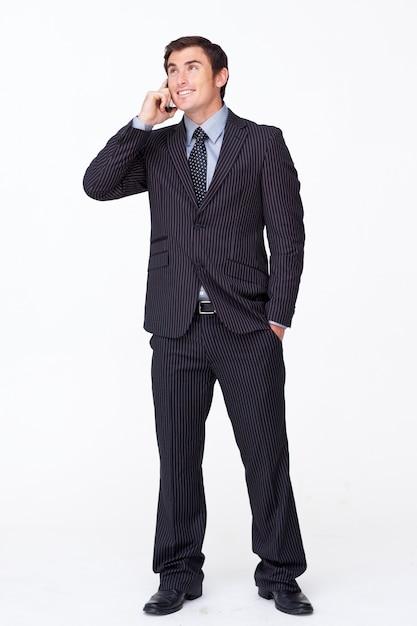 白い携帯電話の魅力的なビジネスマン Premium写真