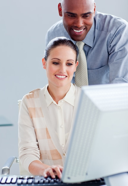 Attractive businesswoman and her manager working at a computer Premium Photo
