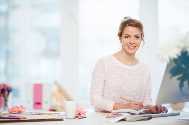 Attractive businesswoman in lovely office Free Photo