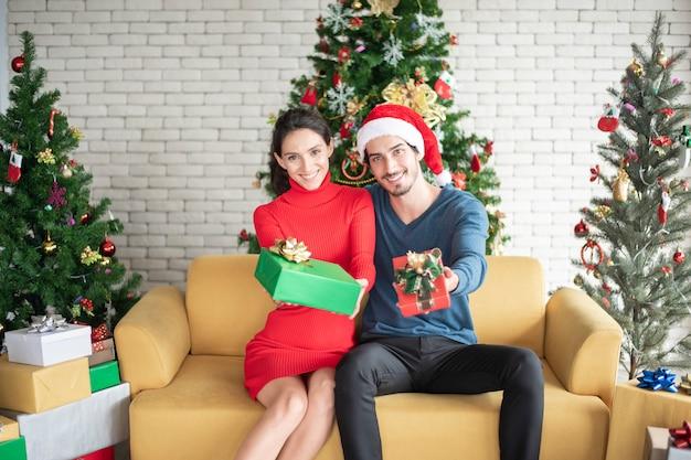 Attractive caucasian couple of love are  celebrating christmas in home Premium Photo