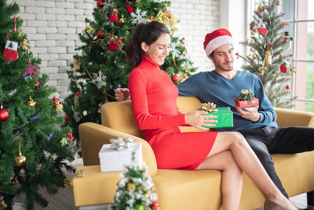 Attractive caucasian couple of love are  celebrating christmas in home Premium Photo