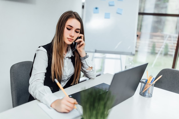 Attractive  clever businesswoman owner of big company has online meeting with international business partners, by phone. Premium Photo