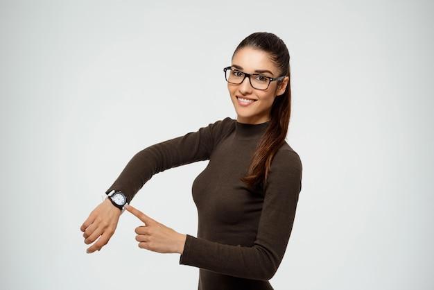 魅力的な自信を持って女性実業家ポイント時計 無料写真