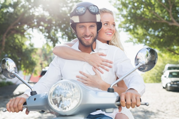 Attractive couple with their scooter Premium Photo