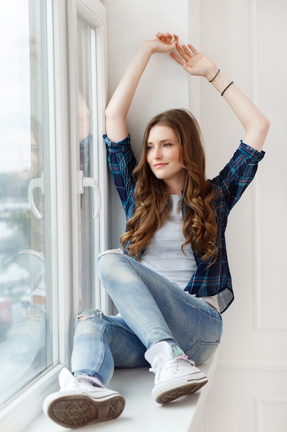 Attractive girl by the window Free Photo