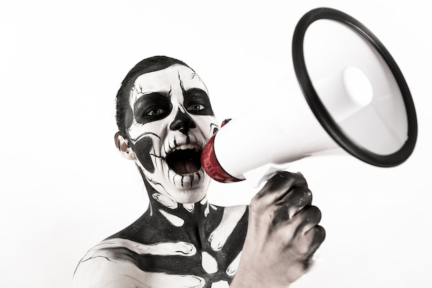 Attractive girl with skeleton makeup hold megaphone Premium Photo