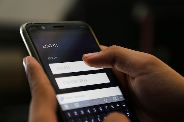 Attractive hands writing sign username on a smart phone Premium Photo