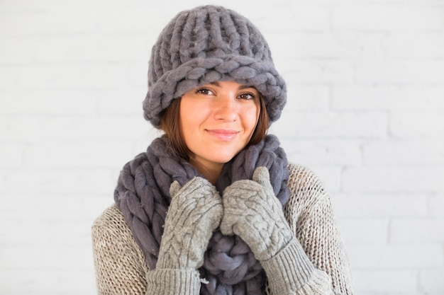 Attractive lady in mittens, hat and scarf Free Photo