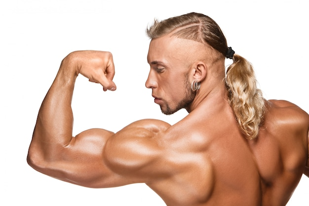 Attractive male body builder on white background Free Photo