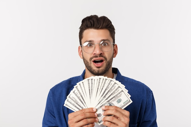 Attractive man is holding cash money in one hand, on Premium Photo