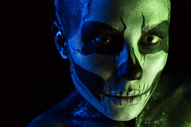 Attractive spooky girl with skeleton makeup Premium Photo