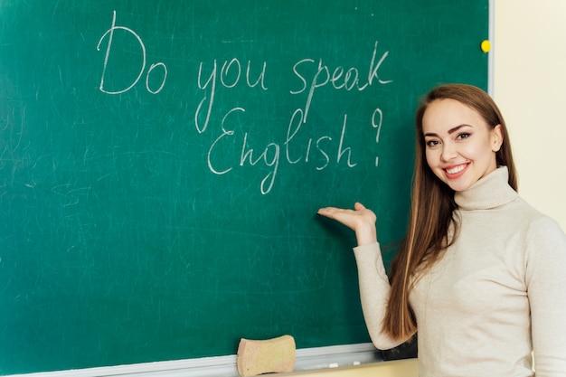 Attractive teacher or student at the blackboard Premium Photo