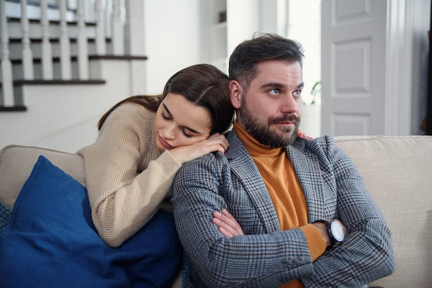 Attractive woman apologizing to frustrated man after quarrel, doubting boyfriend ignore, girlfriend feeling guilty, asking forgive her, begging pardon, admits mistake, regret, couple having problem Premium Photo