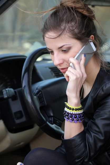 Attractive woman in the car Free Photo