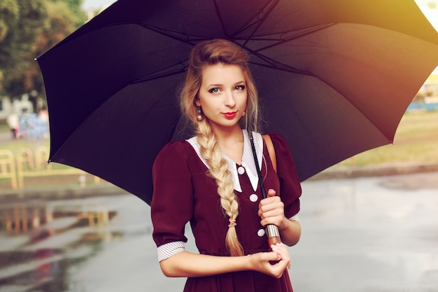 Attractive woman posing with a black umbrella Free Photo